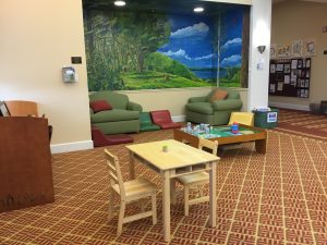 view of comfortable seating and entrance of the children's department at Petoskey District Library