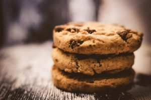 a photo of chocolate chip cookies in a stack